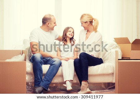family, child, accomodation and home concept - smiling parents and little girl moving into new home - stock photo