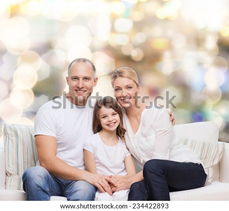 family, childhood, holidays and people concept - smiling mother, father and little girl over lights background - stock photo