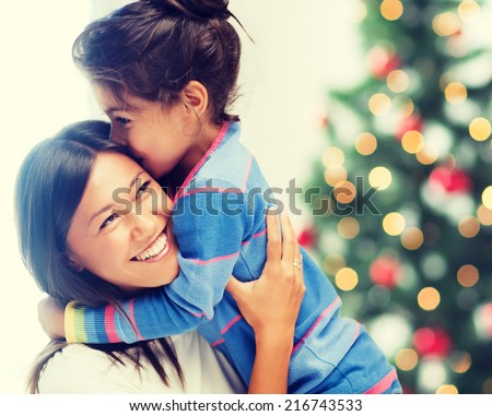 family, children, christmas, x-mas and happy people concept - hugging mother and daughter - stock photo