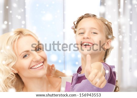 family, children, christmas, x-mas, love concept - happy mother and child (focus on girl) - stock photo