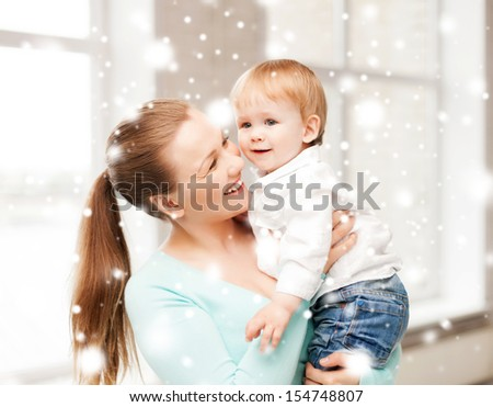 family, children, christmas, x-mas, love concept - happy mother with adorable baby - stock photo