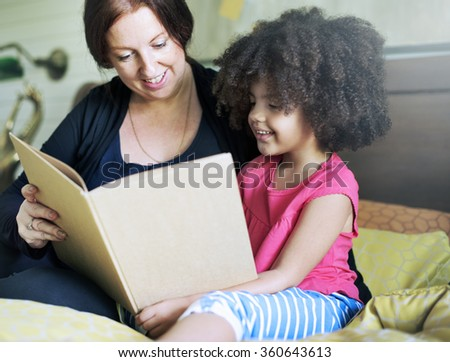 Family Children Daughter Reading Book Bedroom Concept - stock photo
