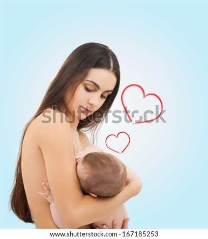 family, children, parenthood and happiness concept - happy mother feeding her adorable baby - stock photo