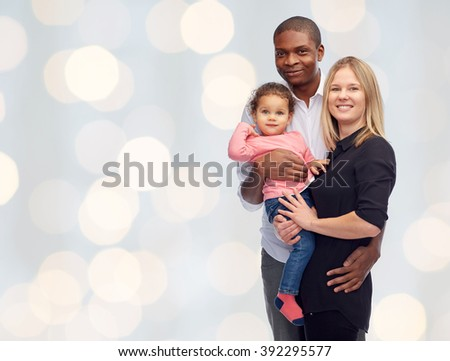 family, children, race and nationality concept - happy multiracial mother, father and little child over holidays lights background - stock photo