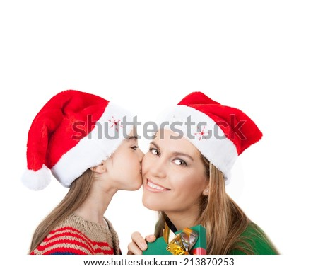 Family, Christmas concept. Adorable child kisses her mother and gives present. Isolated on white. - stock photo