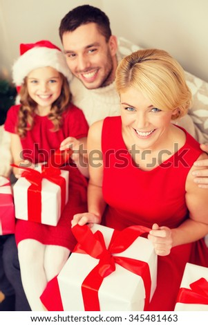 family, christmas, x-mas, happiness and people concept - happy family opening gift boxes - stock photo
