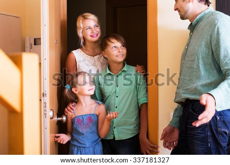 Family coming at threshold with visit to friend. Focus on boy - stock photo