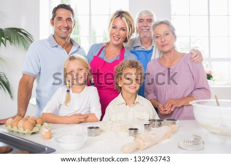 Family cooking together in the kitchen - stock photo