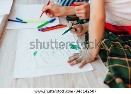 Family Creative Workshop. Child drawing with markers. - stock photo