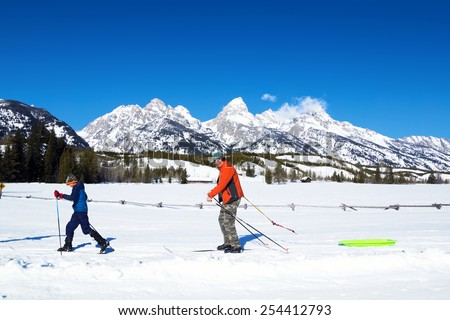 Family Cross-country skiing in Grand Teton National Park, Wyoming, USA - stock photo
