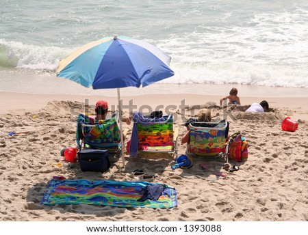 Family Day at the Beach - stock photo