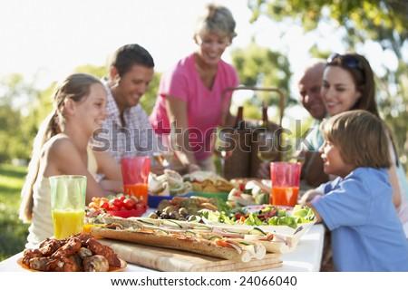 Family Dining Al Fresco - stock photo