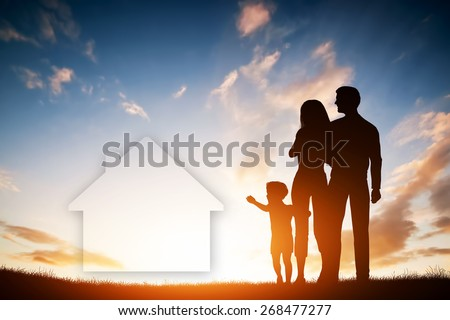 Family dream about a new house, home. Child reaching for a dream with parents. Sunset sun, sky. - stock photo