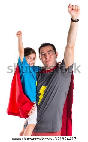 Family dressed like superhero making fly gesture - stock photo