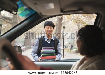 Family dropping off their son at college - stock photo