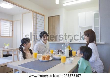 Family eating breakfast - stock photo