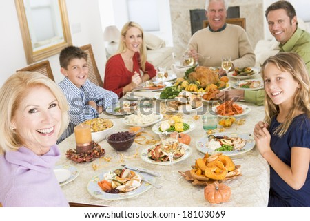 family eating christmas meal - stock photo