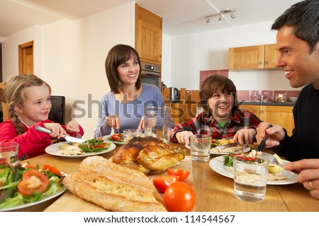 Family Eating Lunch Together In Kitchen - stock photo
