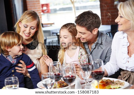 Family eating lunch with their children and the grandmother - stock photo