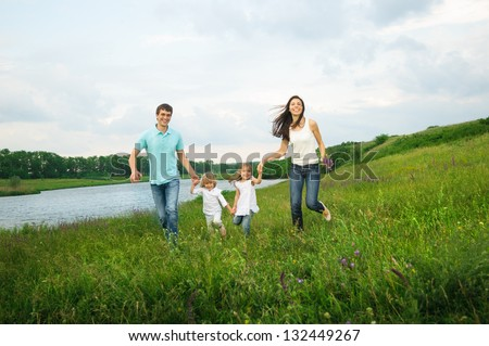 family enjoy picnic outdoors - stock photo