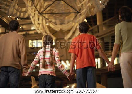 Family Enjoying a Museum Exhibit - stock photo