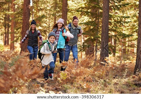 Family enjoying hike in a forest, California, USA - stock photo