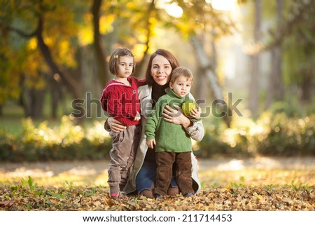 Family enjoying in a autumn park. - stock photo