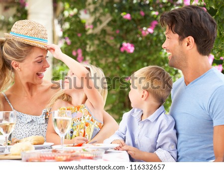 Family Enjoying Meal outdoorss - stock photo
