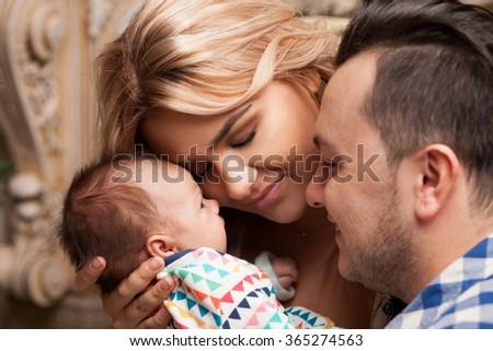 Family Enjoying newborn baby - stock photo
