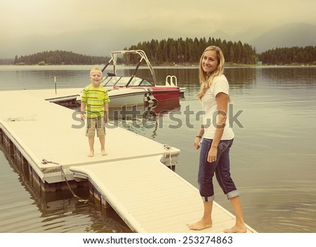 Family enjoying the day at a picturesque lake - stock photo