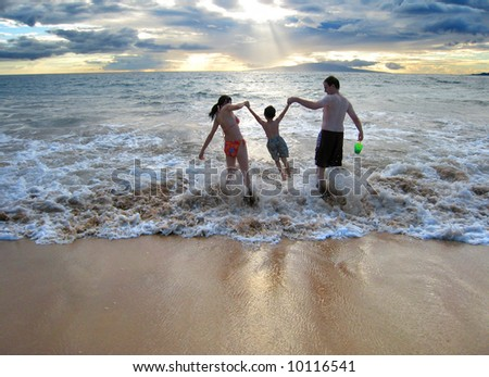 Family enjoying their first summer vacation together - stock photo