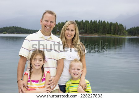 Family enjoying their summer vacation together - stock photo