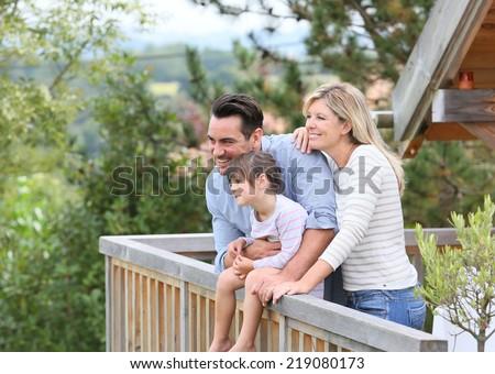 Family enjoying vacation in log cabin - stock photo