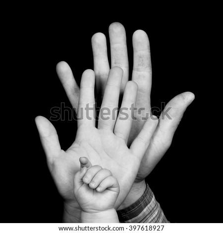 Family. Family hand. Family with baby. Happy Family. Family - hands of father, mother and baby. Happy family. Family hands together.  Family hands on black. Three family hands.   - stock photo