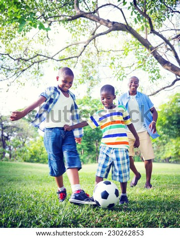 Family Father Son Bonding Sports Socceer Concept - stock photo