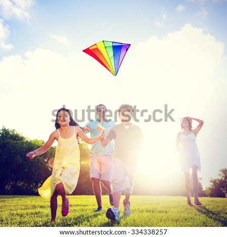 Family Flying Kite Together Outdoors Concept - stock photo