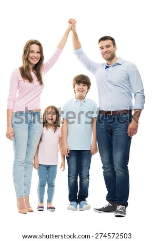 Family forming shape of home - stock photo