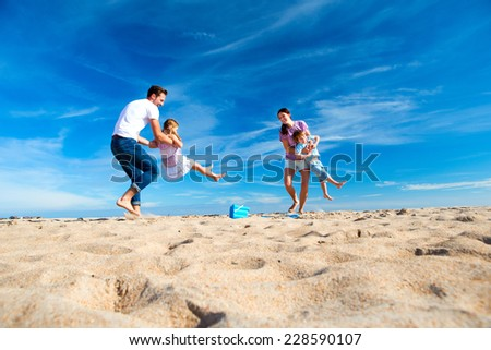 Family Fun Day Out to the Beach - stock photo