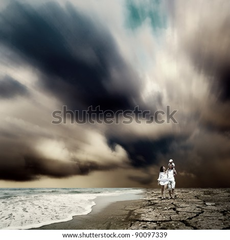 Family fun on the beach - stock photo