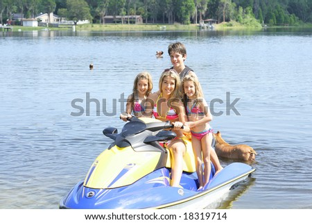 family fun on the water - stock photo