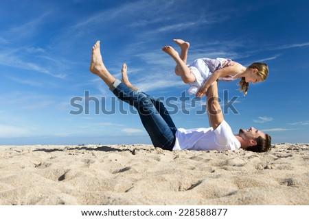 Family Fun Time on the Beach - stock photo