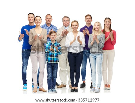 family, gender, generation and people concept - group of smiling men, women and boy applauding - stock photo