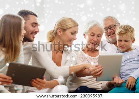 family, generation, technology and people concept - smiling family with tablet pc computers at home - stock photo