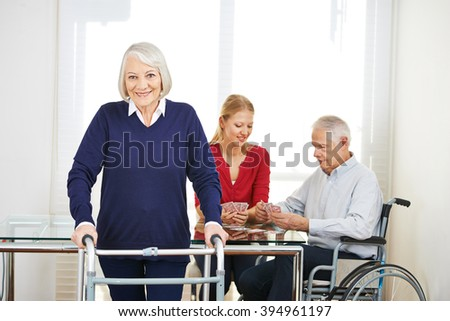 Family generations at home playing cards at table - stock photo