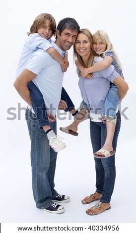 Family giving children piggy back ride against white background - stock photo