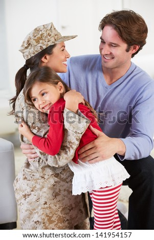 Family Greeting Military Mother Home On Leave - stock photo