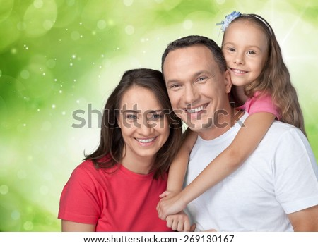 Family. Happy parents piggybacking their children - stock photo