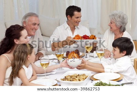 Family having a big dinner together at home - stock photo