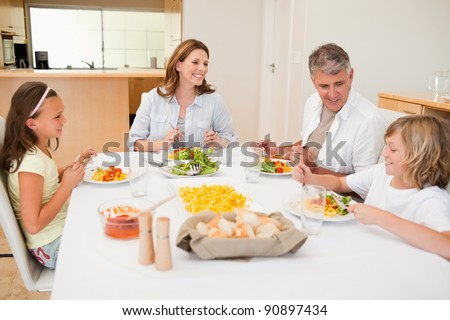 Family having a conversation together while dinner - stock photo
