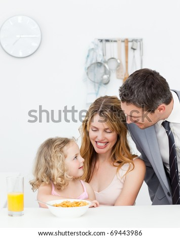 Family having breakfast together at home - stock photo